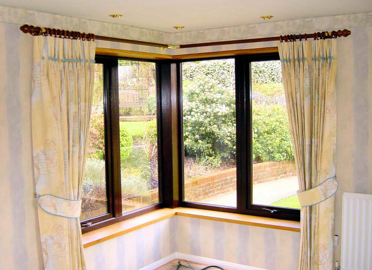 Curtains on a modern corner track